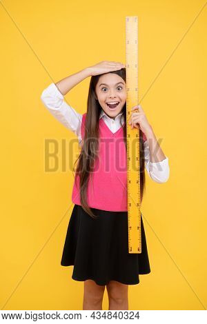 Surprised Kid Girl Use Ruler To Measure The Height, Measurement
