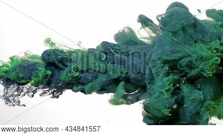 Black And Green Watercolor Ink In Water On A White Background. Black And Green Cloud Of Ink On A Whi