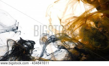 Black And Orange Watercolor Ink In Water On A White Background. Black And Orange Cloud Of Ink On A W