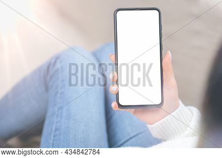 Mockup Cellphone. Over Shoulder View Of Unrecognizable Woman Using Cellphone With Empty Black Screen