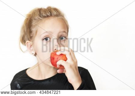 A Girl Eating Delicious Red Peach With Pleasure On A White Background. She Really Loves Fruit, More