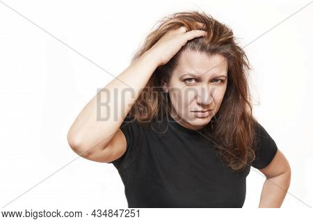 A Good Middle-aged Woman Is Sad On A White Background And Holds Her Hair And Shows That Her Hair Is