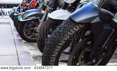 Motorcycles Parked On The Motorcycles Parking Lot On The Street. Closeup View Of Motorcycles Front W
