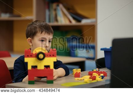 One Kid Choose Parts Of Robotic Electric Toys For His Age Of Four To Build Robots At Robotics School