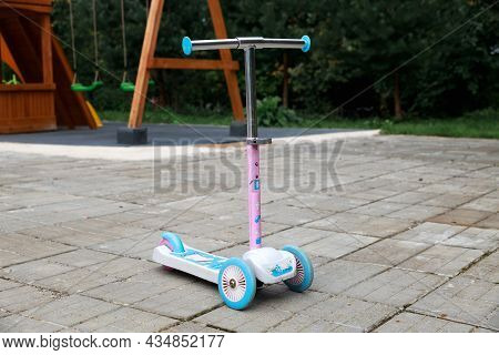 Moscow, Russia - September 5, 2021. Shabby Colorful Kids Scooter.