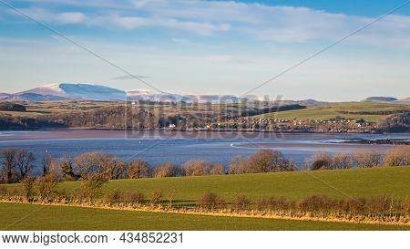 A View Of A Snow Covered Cairnsmore Of Fleet Overlooking Kirkcudbright Bay And Dee Estuary On A Sunn