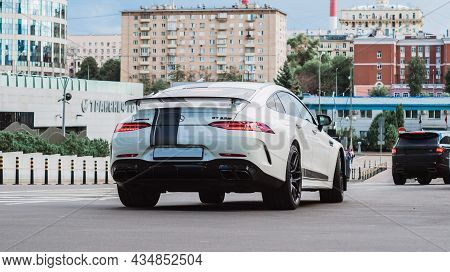Moscow, Russia - August 2021: Mercedes-amg Gt 63 S 4-door Coupe Car On The Street. Rear View Of Whit