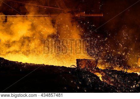 Blast Furnace Metal Release, A Lot Of Smoke. Metal Flows In An Earthen Channel.