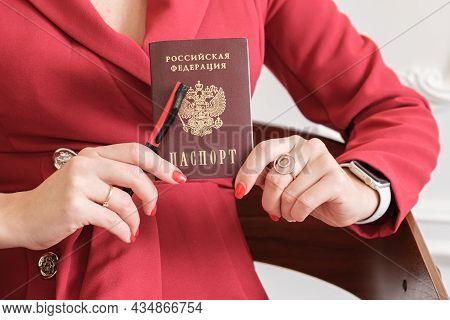 Passport Of A Citizen Of The Russian Federation In The Hands Of A Woman. The Hands Of A Woman In A R