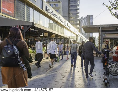 Moscow, Russia - August 22, 2021. Tourists And Local People Walk On Famous Novy Arbat Street. Warm S
