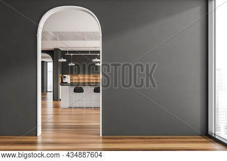 Dark Grey Interior Space With Archways, Floor-to-ceiling Windows, An Empty Wall And Stylish Kitchen