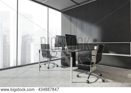 Corner Of The Panoramic Grey Office Interior With A Desk Combination, Two Office Chairs And A Stylis