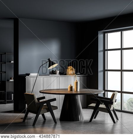 Corner Of The Blue And Grey Living Room Interior With Dark Wood Furniture. Table, Two Easy Armchairs