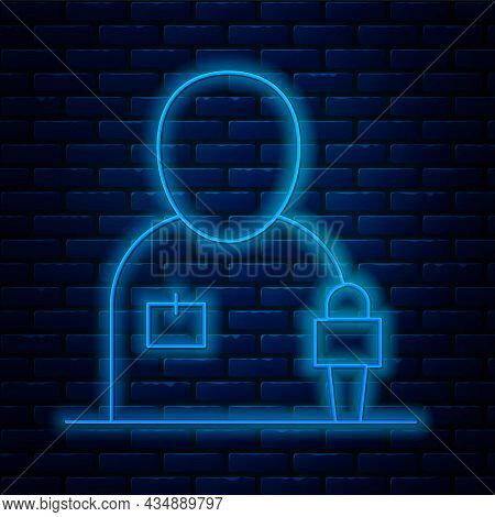 Glowing Neon Line Journalist News Reporter With Microphone Icon Isolated On Brick Wall Background. V