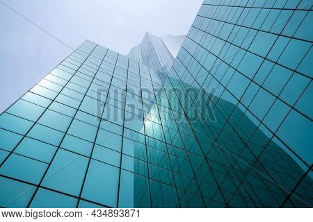 Modern High-rise Office Building Looking For Abstract Background . Contemporary Architecture .