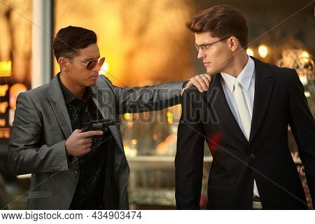 Model Man With Sunglasses And Holding A Gun In Hand Holding Hostage Onever Young Confident Businessm