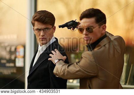 Model Man With Sunglasses And Holding A Gun In Hand Holding Hostage Onever Businessman.