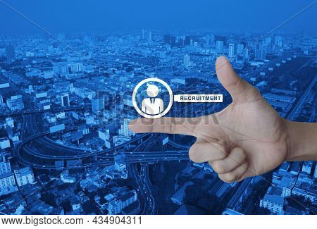 Businessman With Magnifying Glass Icon On Finger Over Modern City Tower, Street, Expressway And Skys