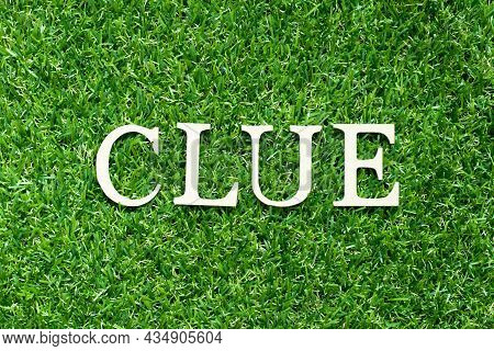 Alphabet Letter In Word Clue On Green Grass Background