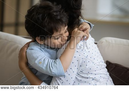 Adorable Little Kid Son Cuddling Affectionate Loving Young Indian Mother.