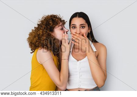 Close Up Photo Of Two Womans Who Gossiping On White Background. High Quality Photo