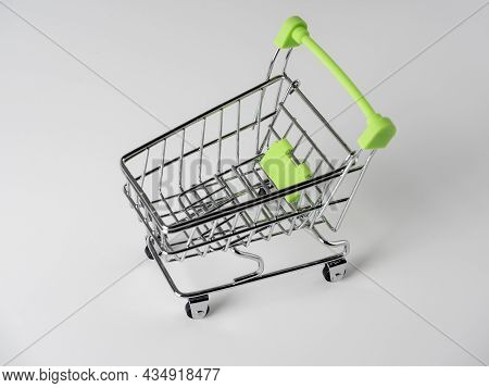 Close-up Of Green Shopping Carts On A White Background. Sales Concept. Cart, Products.