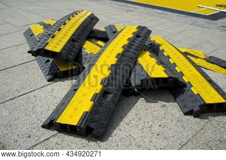Rubber Two Channel Protector Ramp Pilled Up Over Urban Historic Quarter Granite Floor. Heavy Duty Ca