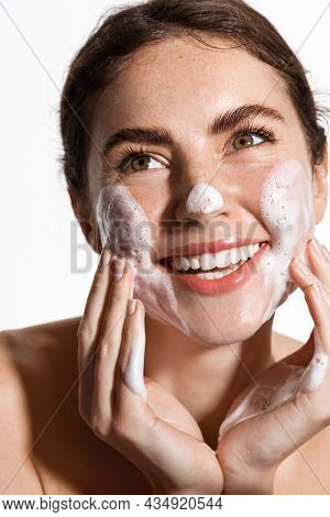 Beauty And Skin Care Concept. Topless Woman Smiling While Cleaning Her Face With Nourishing Cleansin