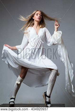 Fashion Portrait Of Young Stylish Woman Wearing Trendy Outfit. Young Elegant Woman In Trendy Dress.