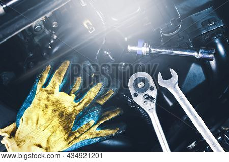 Mechanic Tools Place On The Engine Car Such As Gloves,socket Spanner,combination Wrench