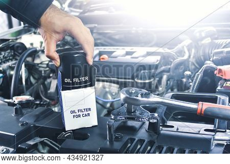 New Oil Filter Unbox Of The Car And Oil Filter Wrench For Engine Oil System Maintenance In The Repai