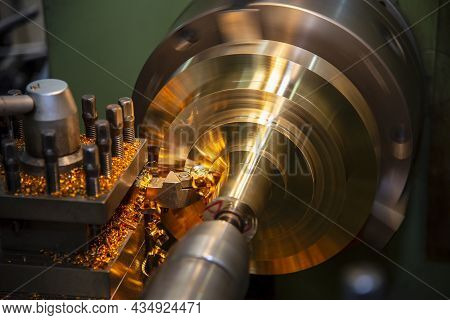 The Lathe Machine Finishing Cut The Brass Shaft Parts By Lathe Tools. The Metalworking Process By Tu