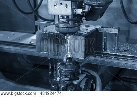 The Wire Edm Machine Cutting The Insert Mold Parts. The Die Insert Cutting Process By Wire Cut Machi