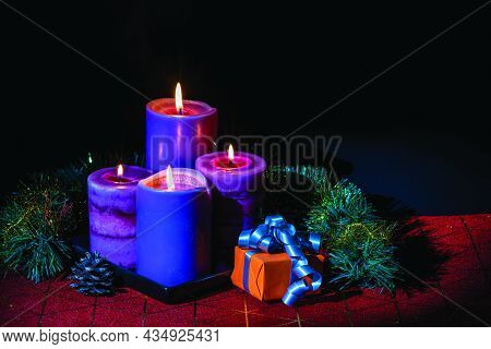 Beautiful View Of Christmas Burning Candles And Decoration Objects Isolation On Black Background.  C