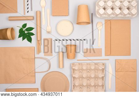 Set Of Different Eco-friendly Tableware And Kraft Paper Food Packaging On Gray Background. Street Fo