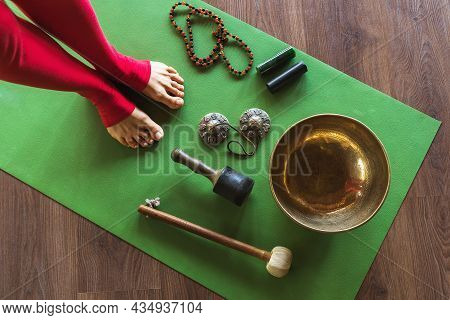 Miscellaneous Props For A Sonic Yoga Class And A Woman's Feet On The Mat
