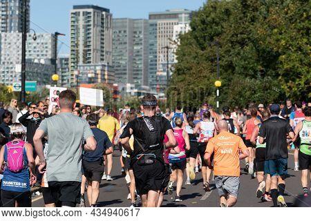 London, Uk - October 3, 2021: Lots Of People Running In London Marathon. People Cheering The Sportsm