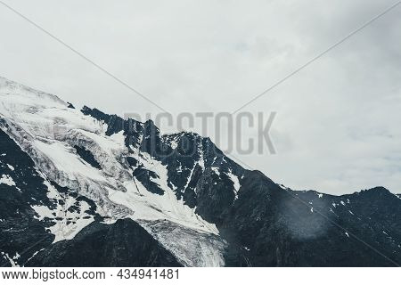 Minimalist Monochrome Atmospheric Mountains Landscape With Big Snowy Mountain Top In Overcast Rainy