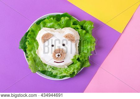Bear Cub, Sandwich For Kids With Wheat Bread And Cheese, Served On Salad Leaves On Geometric Backgro