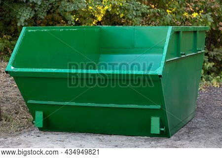 Empty Large Green Metal Container For Construction Or Other Large-sized Garbage Against Background O