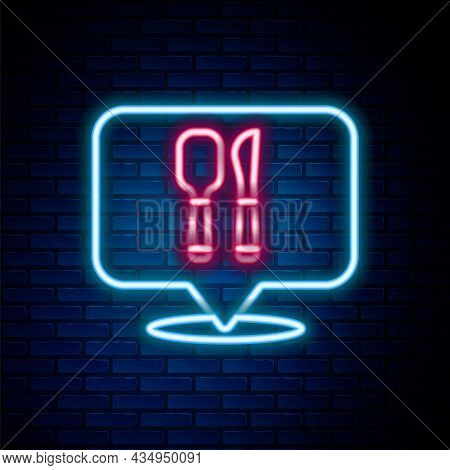 Glowing Neon Line Cafe And Restaurant Location Icon Isolated On Brick Wall Background. Fork And Spoo