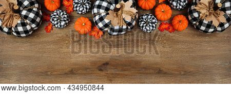 Fall Top Border Of Leaves, Orange, And Black And White Buffalo Plaid Pumpkins Over A Wood Banner Bac