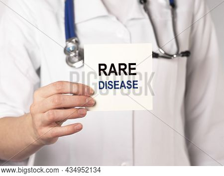 Rare Disease Day, Text On Paper In Hand.