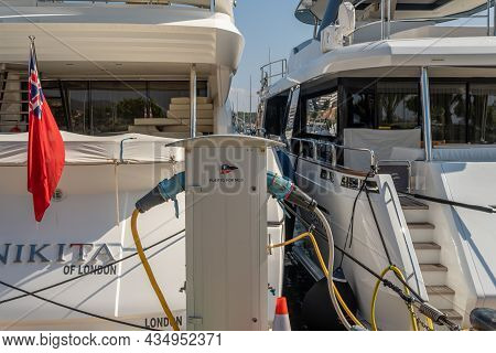 Puerto Portals, Spain; October 02 2021: Close-up Of A Power Station With Two Luxury Yachts Receiving