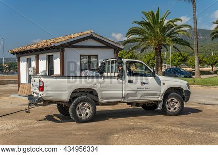 Puerto Portals, Spain; October 02 2021: White Pickup Car With The Puerto Portals Logo For Garbage Co