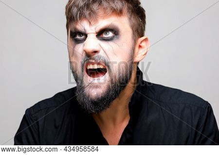 Portrait Of A Man With A Beard And A Menacing Look With Undead-style Makeup On All Saints' Day On Oc