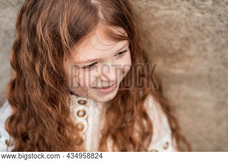 Portrait Of A Cute, Little, Freckled, Ginger Girl In Shirt Smiling