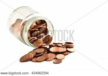 Euro Cent Coins Spilling Out From A Glass Jar On White Background.