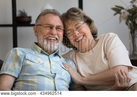 Happy Old Mature Bonding Married Couple Laughing At Funny Joke.