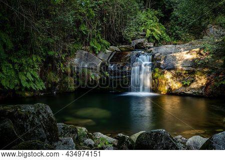 Beautiful Water Stream In Poço Da Cilha Waterfall, Manhouce, São Pedro Do Sul, Portugal. Long Exposu